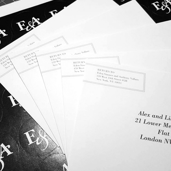 Black and white stickers and envelope printing with guests names